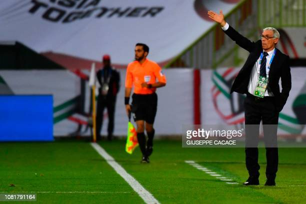 Uzbekistan's coach Hector Raul Cuper speaks to his players during the 2019 AFC Asian Cup group F football match between Turkmenistan and Uzbekistan...