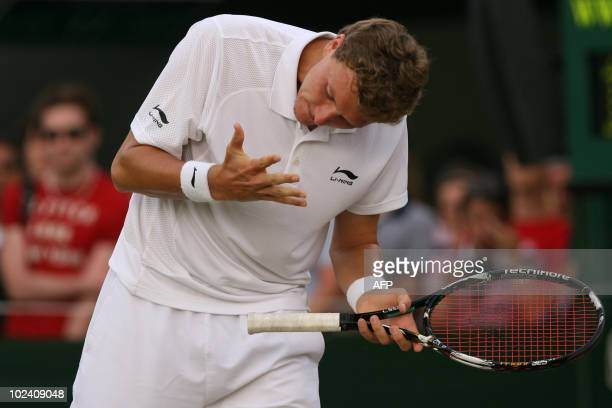 Uzbekistan's Denis Istomin reacts to play against Czech player Tomas Berdych during the Wimbledon Tennis Championships at the All England Tennis Club...