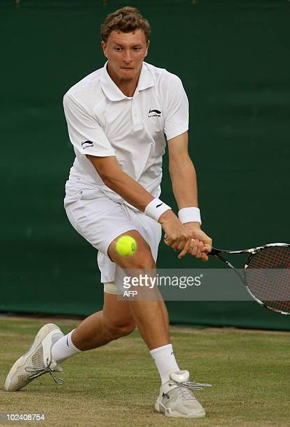Uzbekistan's Denis Istomin returns a ball to Czech player Tomas Berdych during the Wimbledon Tennis Championships at the All England Tennis Club in...