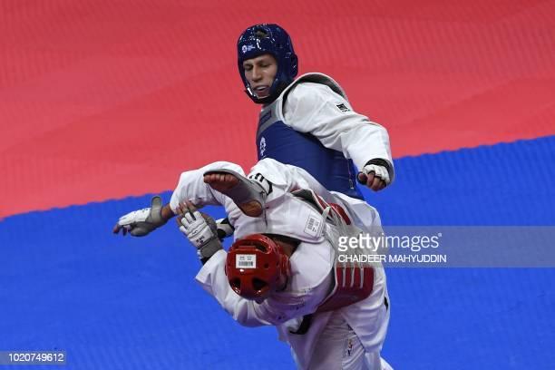 TOPSHOT Uzbekistan's Dmitriy Shokin competes against Iran's Saeid Rajabi during the taekwondo men's 80kg finals at the 2018 Asian Games in Jakarta on...