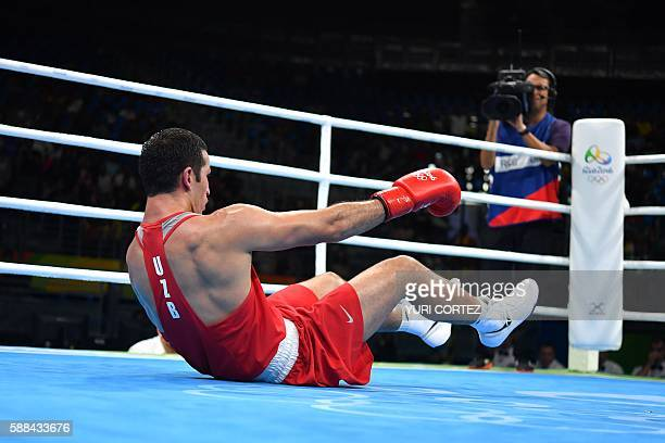 Uzbekistan's Elshod Rasulov is knocked out Great Britain's Joshua Buatsi during the Men's Light Heavy match at the Rio 2016 Olympic Games at the...