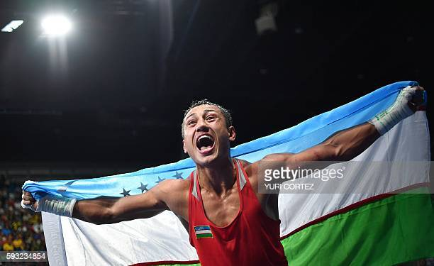 TOPSHOT Uzbekistan's Fazliddin Gaibnazarov celebrates winning against against Azerbaijan's Lorenzo Sotomayor Collazo during the Men's Light Welter...