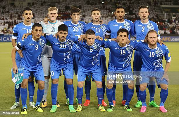 Uzbekistan's first eleven pose for a team photo prior to the World Cup 2018 Asia qualification football match between Uzbekistan and Qatar at the...