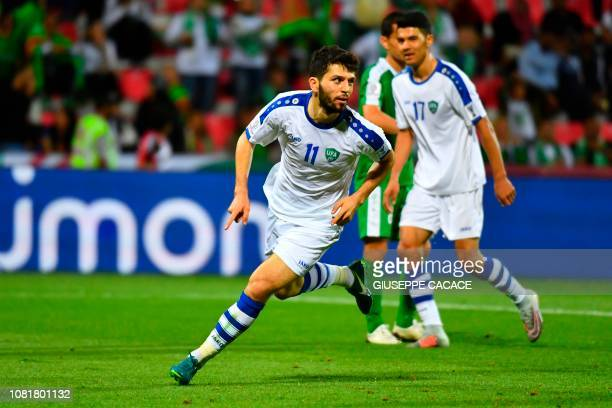 Uzbekistan's forward Jaloliddin Masharipov celebrates his goal during the 2019 AFC Asian Cup group F football match between Turkmenistan and...