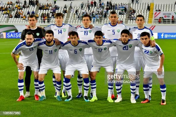Uzbekistan's goalkeeper Ignatiy Nesterov Uzbekistan's forward Eldor Shomurodov Uzbekistan's midfielder Otabek Shukurov Uzbekistan's defender Anzur...