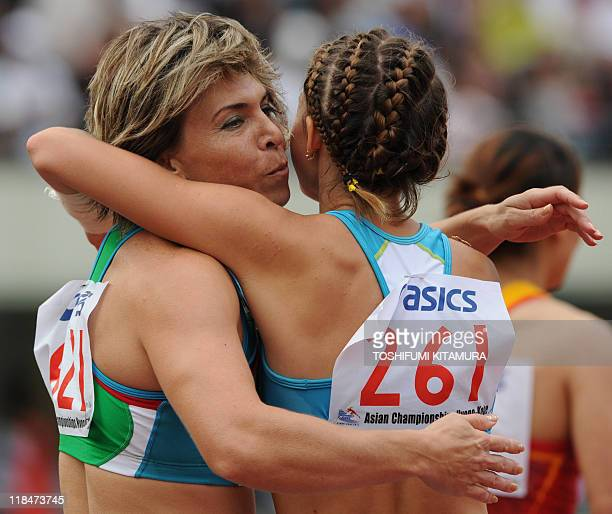 Uzbekistan's Guzel Khubbieva is congratulated by Kazakhstan's Olga Bludova after winning the women's 100metre competition in the 2011 Asian Athletics...