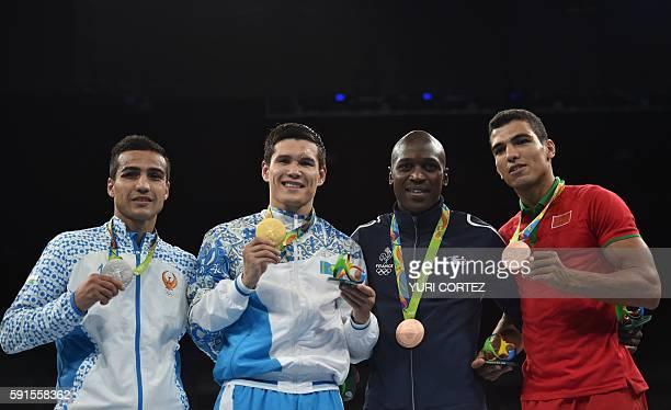Uzbekistan's Shakhram Giyasov Kazakhstan's Daniyar Yeleussinov France's Souleymane Diop Cissokho and Morocco's Mohammed Rabii poses on the podium...