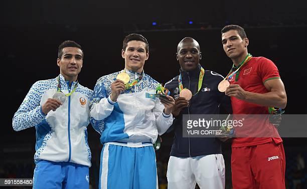Uzbekistan's Shakhram Giyasov Kazakhstan's Daniyar Yeleussinov France's Souleymane Diop Cissokho and Morocco's Mohammed Rabii pose on the podium with...