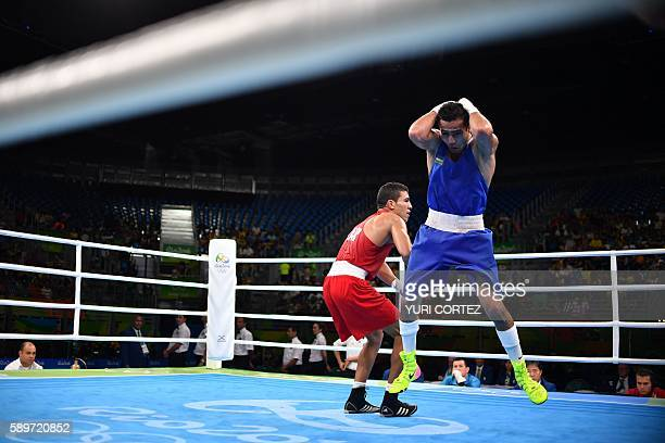 Uzbekistan's Shakhram Giyasov reacts to winning against Morocco's Mohammed Rabii during the Men's Welter Semifinal 1 match at the Rio 2016 Olympic...