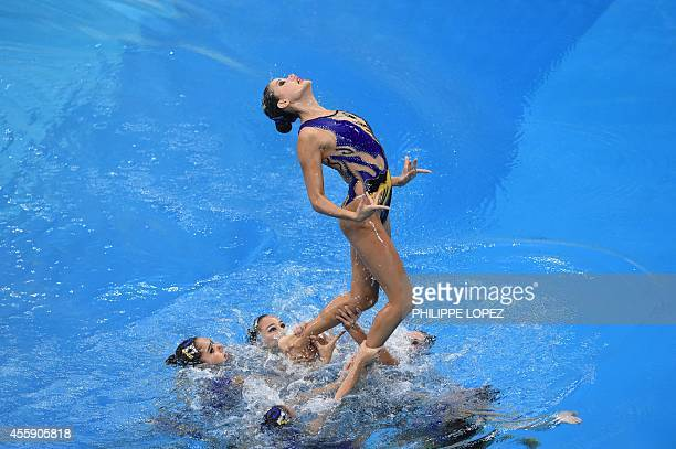 Uzbekistan's team competes in the team free routine final synchronised swimming event during the 2014 Asian Games at the Munhak Park Taehwan Aquatics...