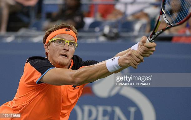 Uzbekistan's tennis player Denis Istomin plays a points against Britain's Andy Murray during their 2013 US Open men's singles match at the USTA...