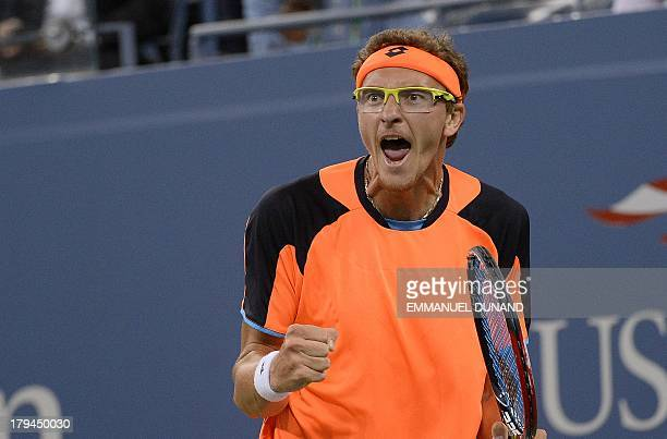 Uzbekistan's tennis player Denis Istomin reacts winning the first set against Britain's Andy Murray during their 2013 US Open men's singles match at...