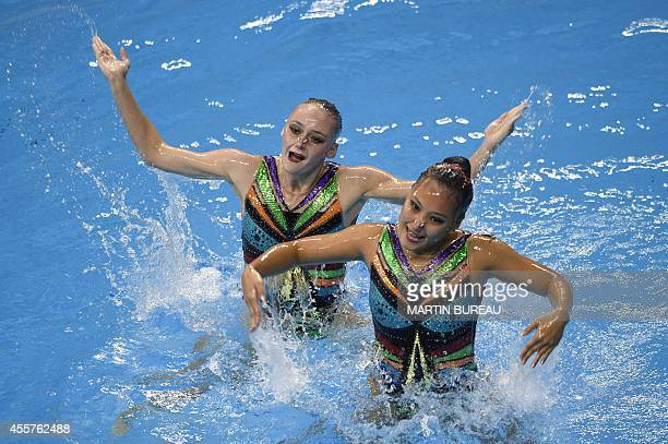 Uzbekistan's Yuliya Kim and Anastasiya Ruzmentov compete in the final of the duets free routine synchronised swimming event during the 2014 Asian...