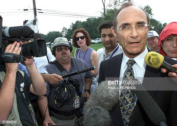 Uzi Landau, a senior member of the Israeli right wing opposition party Likud, speaks with reporters outside Thurmont Elementary School, in Maryland,...