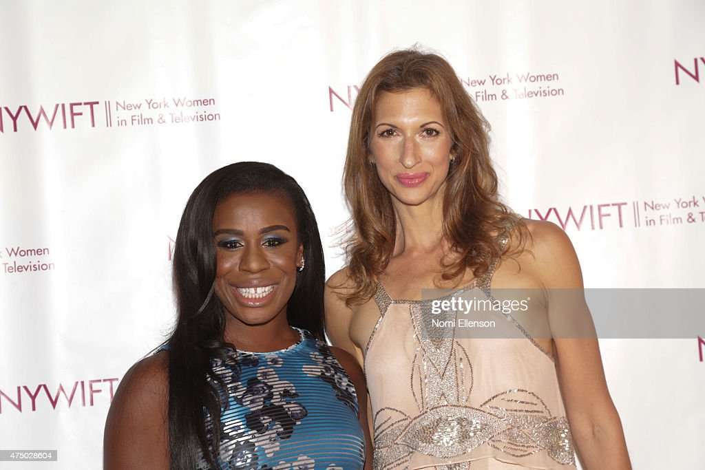 Uzo Aduba and Alysia Reiner attend the 2015 New York Women in Film & Television Designing Women Awards Gala at Scholastic Auditorium on May 28, 2015 in New York City.