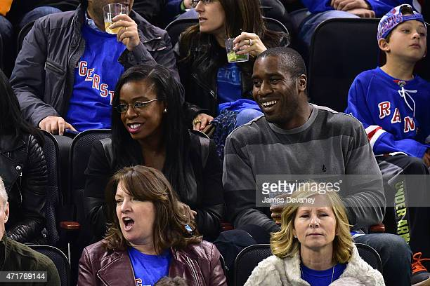 Uzo Aduba and guest attend the Washington Capitals vs New York Rangers playoff game at Madison Square Garden on April 30 2015 in New York City