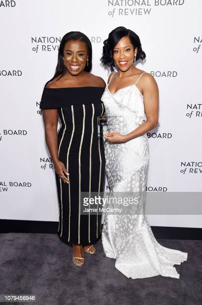 Uzo Aduba and Regina King pose with an award backstage during The National Board of Review Annual Awards Gala at Cipriani 42nd Street on January 8,...