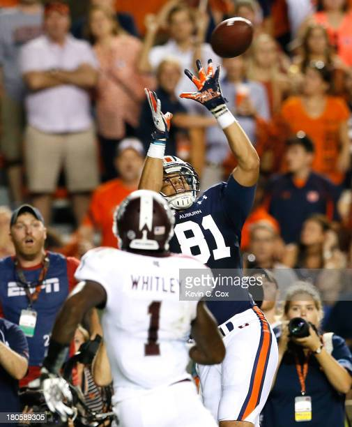 J Uzomah of the Auburn Tigers catches the goahead touchdown in the final seconds against Nickoe Whitley of the Mississippi State Bulldogs at...