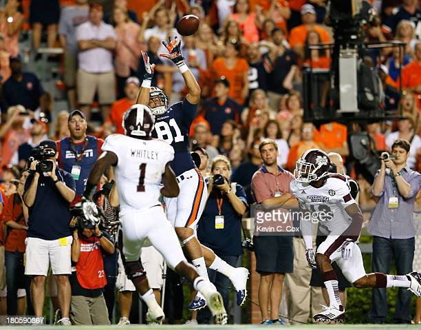 J Uzomah of the Auburn Tigers catches the goahead touchdown in the final seconds against Cedric Jiles and Nickoe Whitley of the Mississippi State...