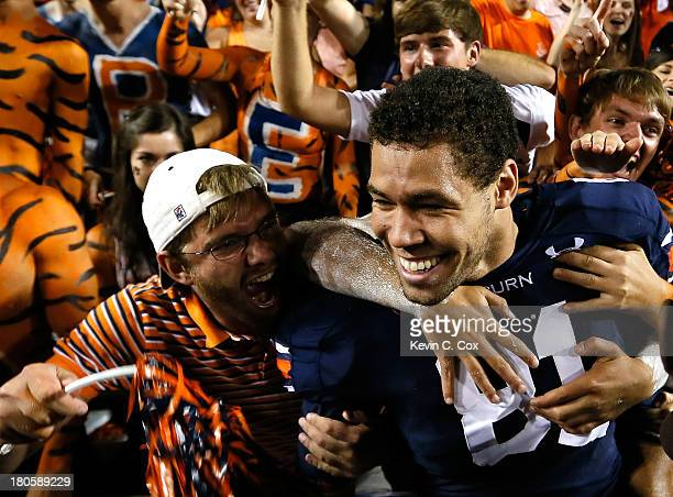 J Uzomah of the Auburn Tigers celebrates with fans after their 2420 win over the Mississippi State Bulldogs at JordanHare Stadium on September 14...