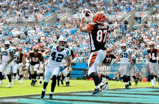 J Uzomah of the Cincinnati Bengals catches a touchdown against the Carolina Panthers in the second quarter during their game at Bank of America...