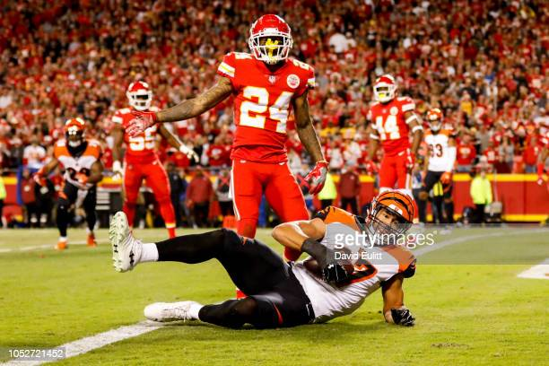 J Uzomah of the Cincinnati Bengals crosses the goal line after a catch for a touchdown in front of Jordan Lucas of the Kansas City Chiefs during the...