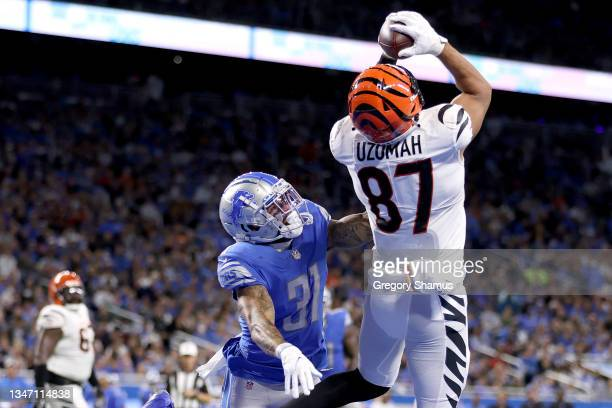 Uzomah of the Cincinnati Bengals scores a touchdown against Dean Marlowe of the Detroit Lions during the fourth quarter at Ford Field on October 17,...