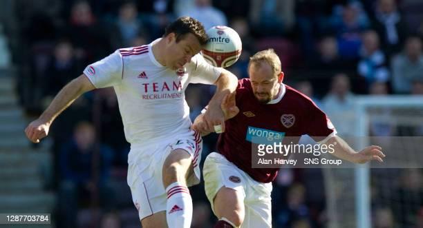 V ABERDEEN.TYNECASTLE - EDINBURGH.Gavin Rae battles for the ball with Hearts' Jamie Hamill