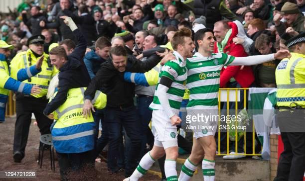 V CELTIC .FIR PARK - MOTHERWELL .Celtic's Tom Rogic celebrates his goal with team-mate Stuart Armstrong