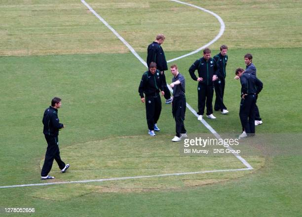 V CELTIC .RFK STADIUM - WASHINGTON DC .Celtic players get their first look at the poorly patched playing surface .