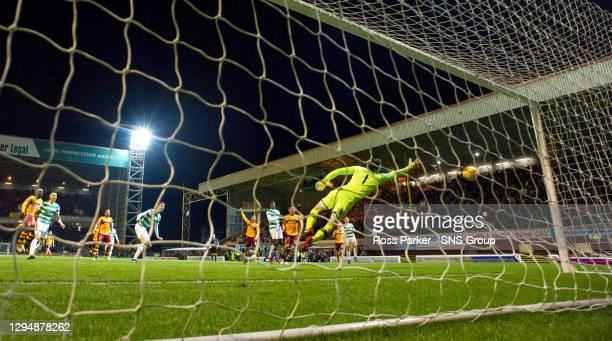 V CELTIC.FIR PARK - MOTHERWELL.Celtic goalkeeper Craig Gordon cannot stop Mikael Lustig's sliced clearance from flying past him