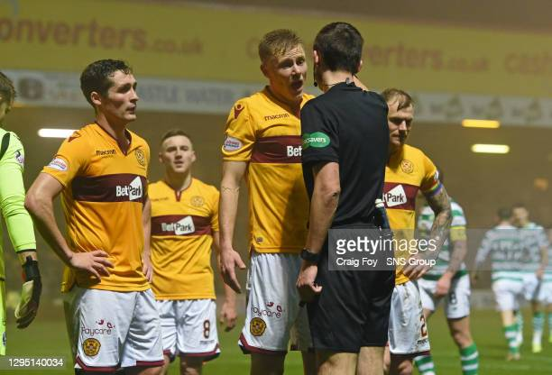 V CELTIC.FIR PARK - MOTHERWELL.Motherwell's players complain after Referee Kevin Clancy awards the away side a penalty,