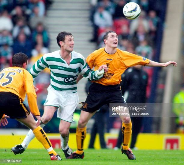 V CELTIC.HAMPDEN - GLASGOW.David McNamee of Livingston does what he can to keep Chris Sutton from getting to the ball