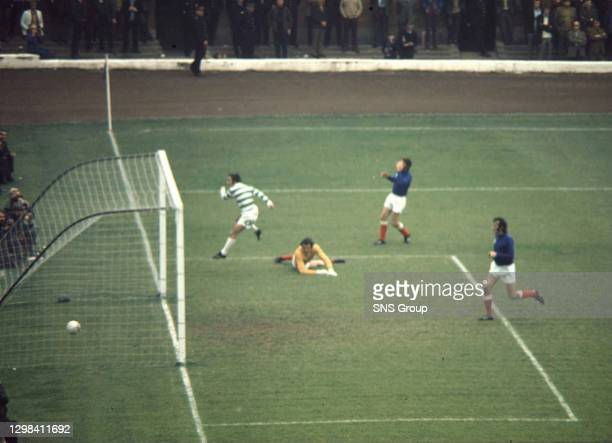 V CELTICLou McCari slides the ball past Rangers keeper Peter McCloy to score for Celtic