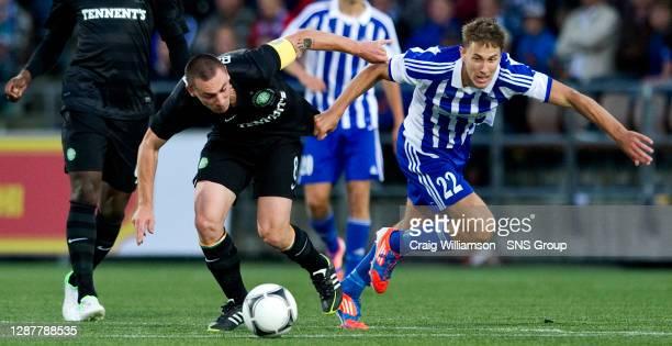 V CELTIC.SONERA STADIUM - HELSINKI.Celtic captain Scott Brown battles it out with Joel Perovuo