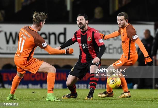 V DUMBARTON FC.TANNADICE - DUNDEE.Dumbarton's Dimitris Froxylias takes on Billy King and Paul McMullan