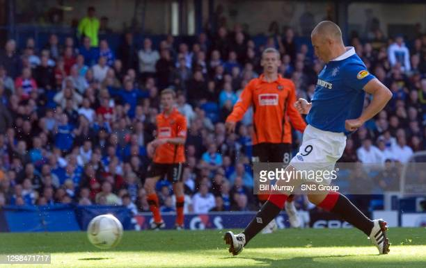 V DUNDEE UTD.IBROX - GLASGOW.Kenny Miller slots the ball home to increase Rangers lead