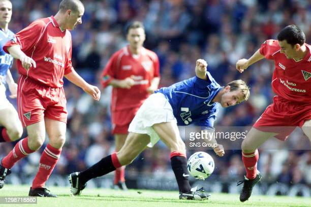 V DUNFERMLINE .IBROX - GLASGOW.Rangers' Neil McCann loses his footing whilst on the run.