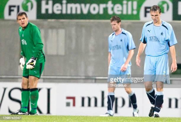 V FALKIRK .VADUZ - LIECHTENSTEIN.Falkirk keeper Robert Olejnik Brian McLean and Marc Twaddle trudge off at the final whistle