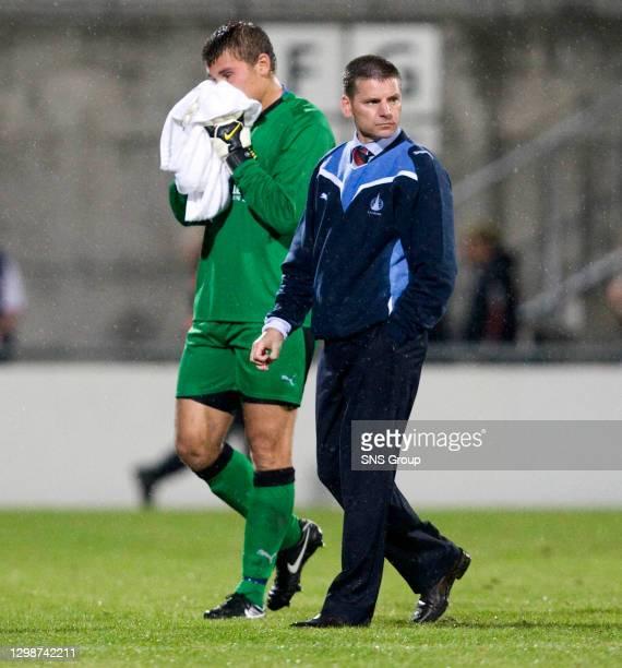 V FALKIRK.VADUZ - LIECHTENSTEIN.Robert Olejnik makes his way off the field alongside Falkirk manager Eddie May
