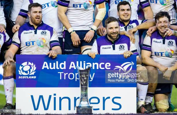V FRANCE.BT MURRAYFIELD STADIUM - EDINBURGH .The Scotland players celebrate with the Auld Alliance trophy at full time .