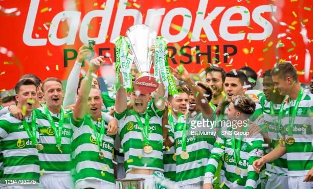 V HEARTS . CELTIC PARK - GLASGOW. Celtic's Kieran Tierney lifts the Ladbrokes Premiership trophy