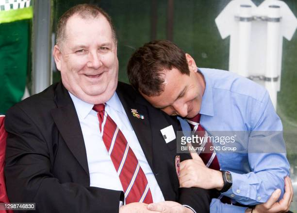 V HEARTS .CELTIC PARK - GLASGOW .Hearts manager Csaba Laszlo gets cosy with the team bus driver in the dugout...