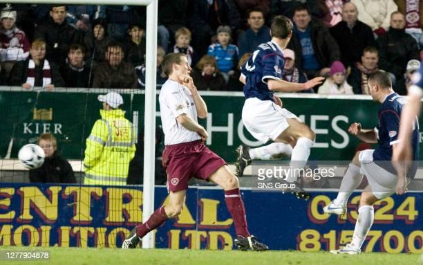 V HEARTS .FALKIRK STADIUM - WESTFIELD.Michael Higdon slots home Falkirk's late winner to heap more misery on Hearts