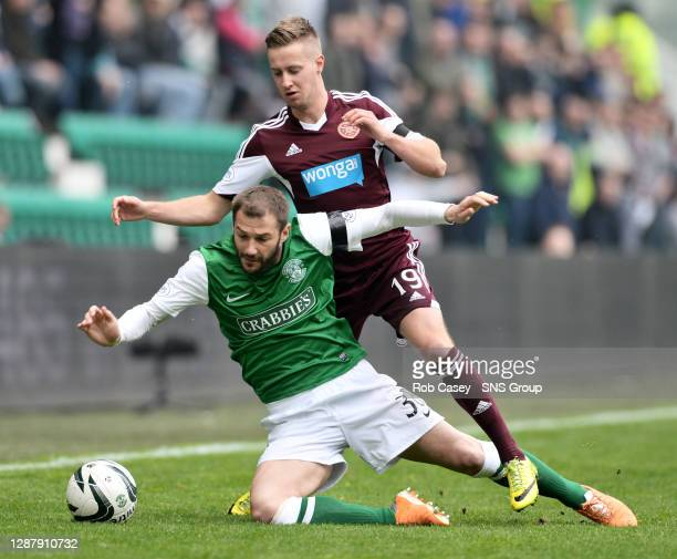 V HEARTS.EASTER ROAD STADIUM - EDINBURGH.Hibernian's Kevin Thomson struggles to keep his footing as he is challenged by Billy King.