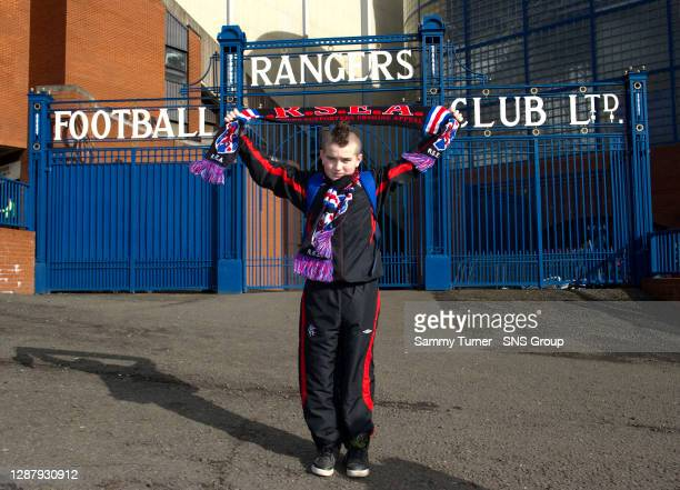 V HEARTS.IBROX - GLASGOW.A young Rangers fan hoists his scarf in the air as he makes his way into the ground