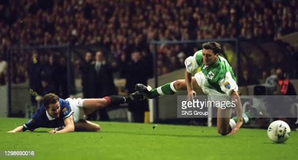 V HIBS .IBROX - GLASGOW.Rangers defender Alex Cleland and Pat McGinlay lose their footing.