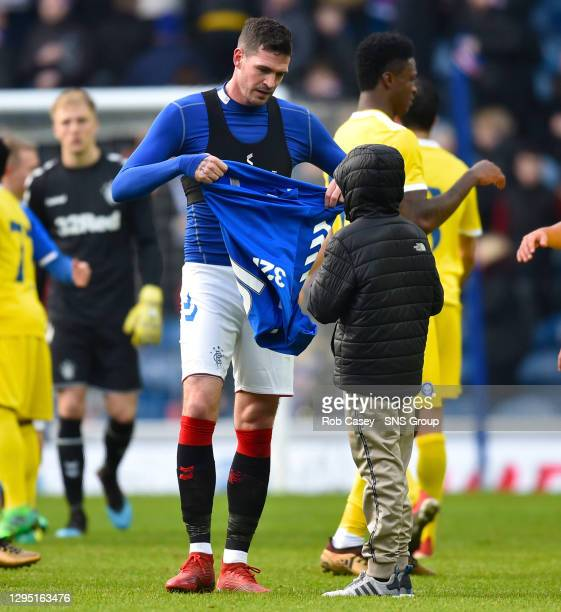 V HJK HELSINKI.IBROX - GLASGOW .A young Rangers fan runs on the field at full time and gets Kyle Lafferty's shirt from the striker