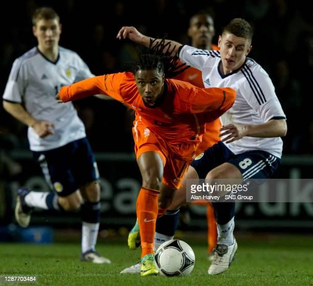 V HOLLAND.ST MIRREN PARK - PAISLEY.Lerin Duarte pulls away from Scotland U21's Thomas Cairney