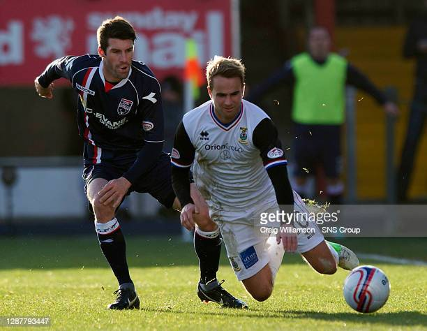 V ICT.GLOBAL ENERGY STADIUM - DINGWALL.ICT's Andrew Shinnie loses his footing under pressure from Rocco Quinn